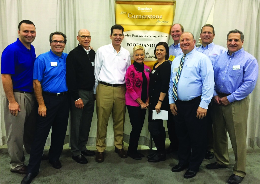 The FoodHandler management and sales teams receive a 2015 U.S. Cornerstone Partner Award from Gordon Food Service at the company's Vendor Involvement Process supplier awards on Oct. 5 in Grand Rapids, Mich.